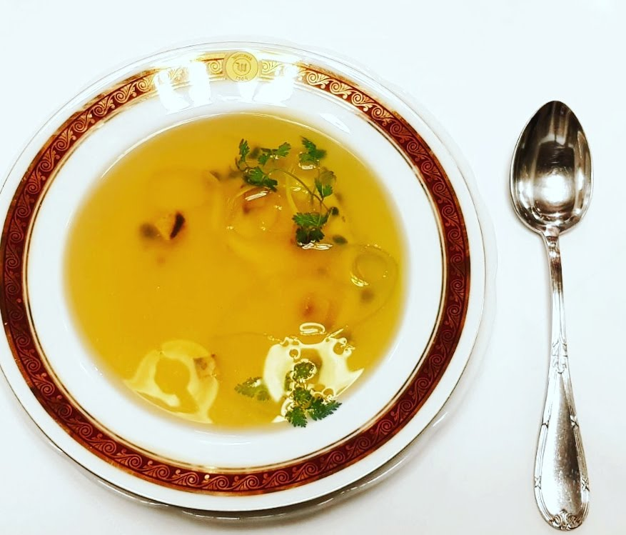 consomme with celery-herb caviar